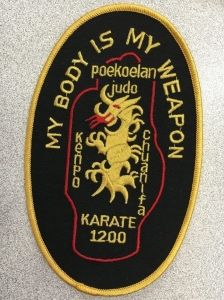 "embroidery badge that says ""My body is my weapon"""